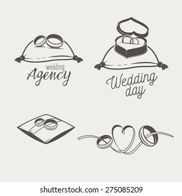 Set of logos for bridal salon, agency. Two  wedding  crossed rings on a pillow, in a box and with ribbon