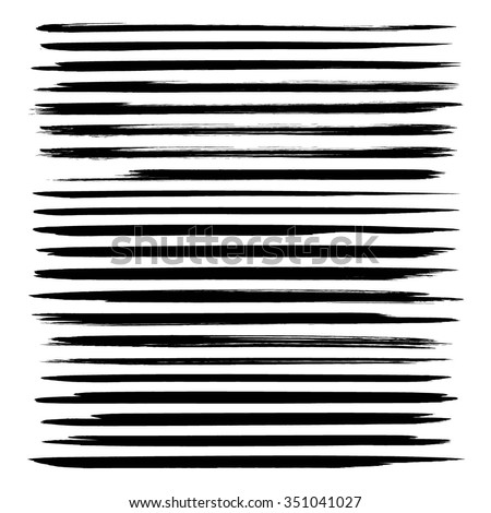 Set of long thin strokes of black paint isolated on white background