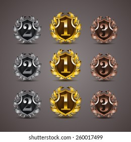 Set of luxury golden vector shields with laurel wreaths, ribbons. 1st, 2nd, 3rd places. Royal heraldic emblem, icons, label, badge, blazon for web, page design. Vector illustration EPS 10.
