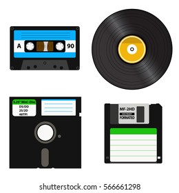 Set of media of different generations: vinyl record, cassette tape, a 3.5-inch floppy disk on a 5.25-inch diskette. Isolated on white background.