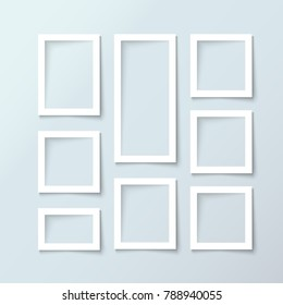 Set of minimalist white blank picture frame with place for photo and text on gray wall