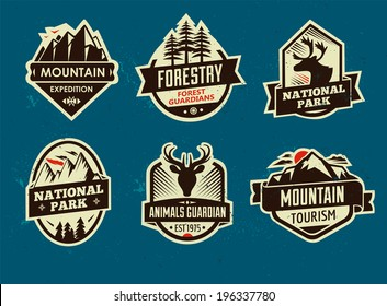 Set of mountain adventure and travel emblems. Vector