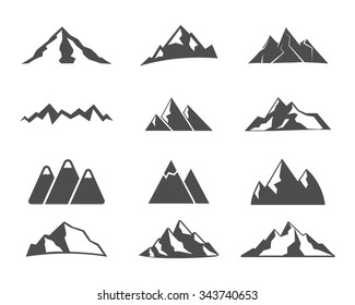 Set of mountain silhouette elements. Outdoor icon. Hand drawn snow ice mountain tops, decorative symbols isolated. Use them for camping logo, travel labels, climbing or hiking badges. Vector.