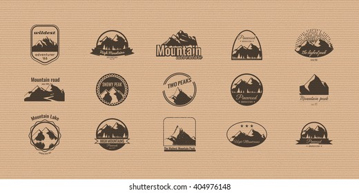 Set of mountains logotypes on the cardboard background. Stock vector.