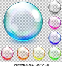 Set of multicolored transparent glass spheres on a plaid background