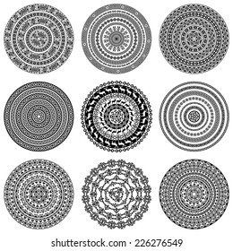 Set of nine 9 ethnic monochromatic round design elements isolated on white background. Can be used for invitation, menu, card design, for pillow design, banners, signs and others. Vector illustration