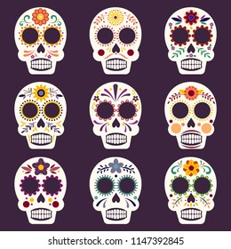 Set of nine colorful and decorative Mexican sugar skulls for Day of the Dead