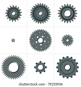Set of nine different cog wheels / pinions, gear set.