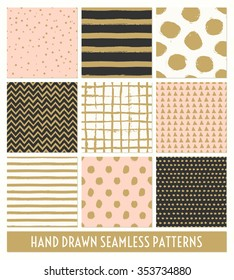 A set of nine hand drawn seamless patterns in black, gold, pastel pink and cream. Stripes, polka dots, triangles, chevron, round brush stroke patterns.