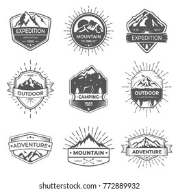 Set of nine vector mountain and outdoor adventures logo. Logotype templates and badges with mountains, trees, tent