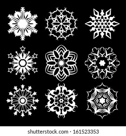 Set of nine white snowflakes on black background. eps10