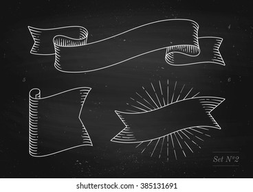 Set of old vintage ribbon banners in engraving style on a black chalkboard background and texture. Hand drawn design element. Vector illustration