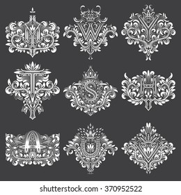 Set of ornamental monogram in coats of arms form. White floral decorations on black. Isolated tattoos in vintage baroque style.