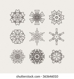 Set of ornate vector mandala symbols. Gothic lace tattoo. Celtic weave with sharp corners. The circular pattern.