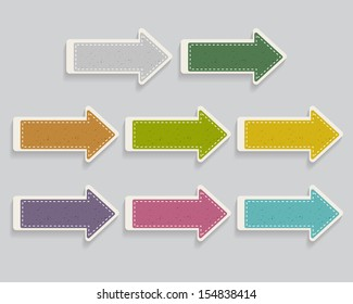 set of paper arrows with a texture