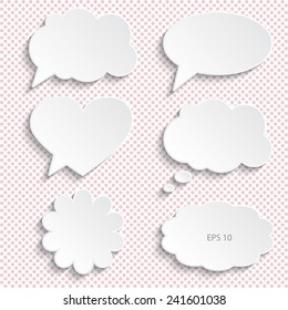 Set of paper speech bubbles, vector illustration. Background with polka dots.