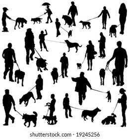 set of people with dogs