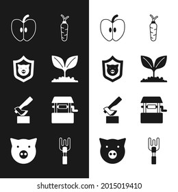Set Plant, Shield with pig, Apple, Carrot, Wooden axe, Well, Garden rake and Pig icon. Vector