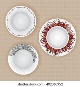 A set of plates with fancy pattern.