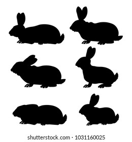 Set of rabbits in different poses. Vector black silhouettes on white background