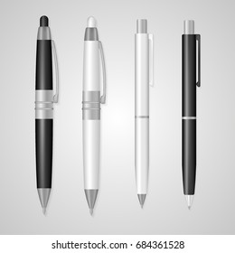Set of realistic 3d pens made in classic white and black colors with silver details isolated on white. Writing tools with empty space for branding, corporate logo, design mock up. Business symbol.