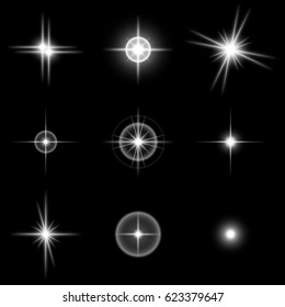 Set of the realistic beautiful white star flashes on a black background. Vector illustration. It is possible to use on transparent and any background.