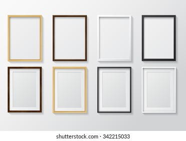 Set of Realistic Light Wood Blank Picture Frames and Dark Wood Blank Picture Frames, hanging on a White Wall from the Front.  White and Black Blank Picture Frames.  Design Template for Mock Up.