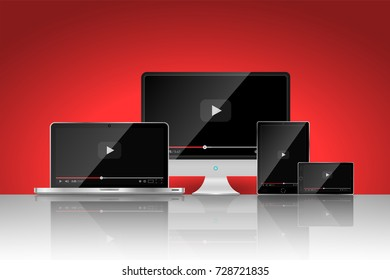 Set of realistic modern digital devices with reflections on red background. Video player template. Vector illustration
