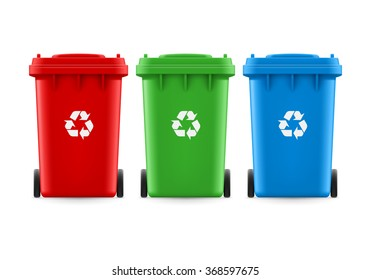 Set of red green and blue buckets for trash with sign arrow