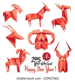 Set of red origami goats - symbols of 2015 New Year. Translation of calligraphy: Goat