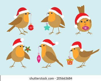 Set of Robins in Santa hats with Christmas decorations.