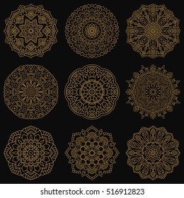 Set with round gold patterns. Collection of mandalas on a white background