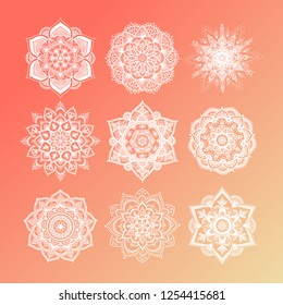 Set of round gradient mandala on living coral color of the year. Vector hipster white mandala on rose pink background. Mandala with floral patterns. Yoga template.