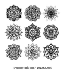 Set of round hand drawn mandala on white isolated background. Vector hipster mandala in monochrome. Mandala with floral patterns. Yoga template.
