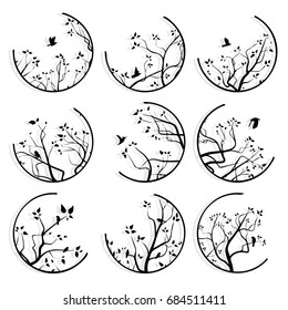 Set of round icons stylized tree branches and birds with its shadow.