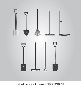 Set of  silhouette images stickers with garden tools. fork, spade, hoe, rake, lawn rake vector eps10 illustration.