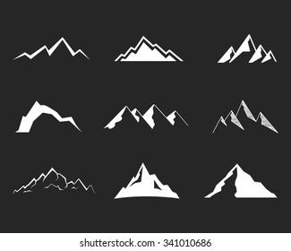 Set of silhouette mountain . Outdoor icons. Hand drawn snow ice tops, decorative symbols isolated. Use them for camping logo, travel labels, climbing or hiking badges. Vector.