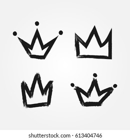 Set of silhouettes of crowns. Painted by hand with a rough brush. Isolated black icons. Grunge. Vector illustration.