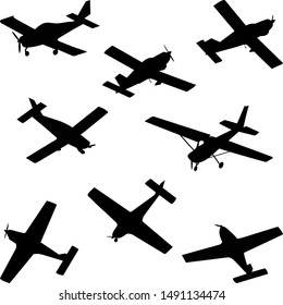set of silhouettes of light aircraft