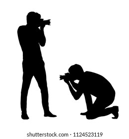 Set silhouettes man photographing with a camera isolated on white background vectorSet silhouettes man photographing with a camera isolated on white background - vector