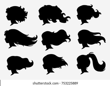 Set of silhouettes of a profile of girls with flying hair. Vector.
