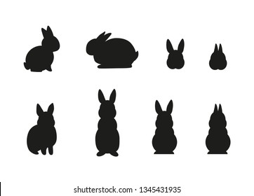 Set of simple black different rabbit silhouettes isolated on white background. - Vector