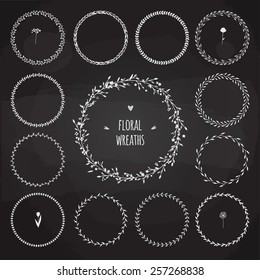 set of simple hand drawn floral wreaths on dark background, thirteen different wreathes