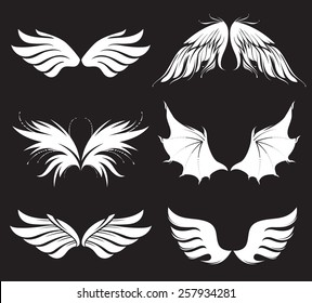 Set of six vector black wings of different level of specification in vector.