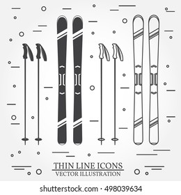 Set of skiing equipment silhouette icons. Set include skis and ski poles . Winter equipment icons for family vacation, activity or travel. For logo design, patches, seal, logo or badges.