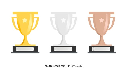 Set of sports trophy cups in gold, silver and bronze or award for event with blank name plate on pedestal