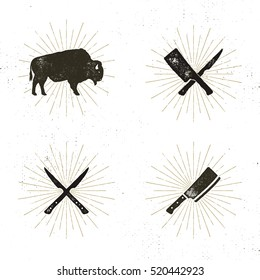 Set of steak house, butcher house and meat tools - crossed carving knives for steaks, cut, bison with sun bursts. Retro symbols of bbq equipment with letterpress effect. Stock vector.