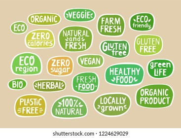 Set of stickers with handmade lettering for bio production, organic food, packaging.