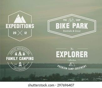 Set of Summer, winter explorer, family camp badge, logo and label templates. Travel, hiking, biking style. Outdoor. Best for adventure sites, travel magazine etc. On blurred vintage background. Vector
