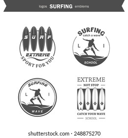 Set of surfing logos, emblems and design elements